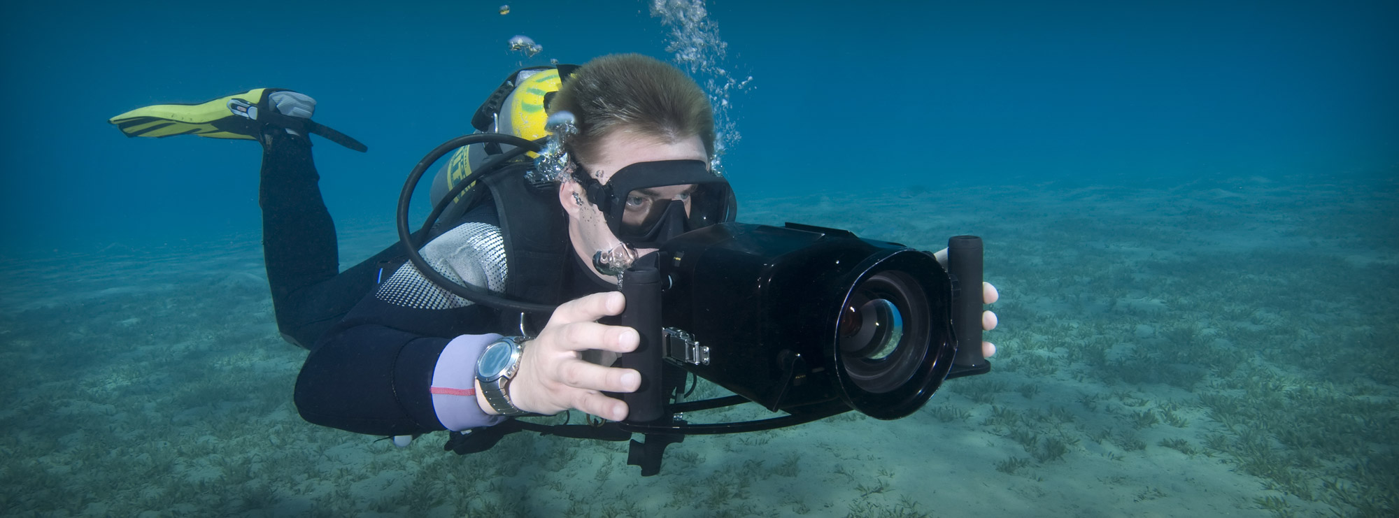 Underwater Cameraman Filming in Crystal Clear Water